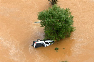 A submerged truck is shown in flood waters in Mableton, Ga., Tuesday, Sept. 22, 2009. Heavy rains caused flooding in and around the Atlanta area. (AP Photo/John Bazemore)