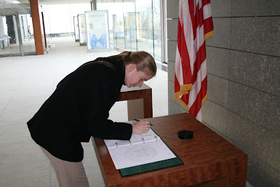 Ashley signs the guestbook at the American Military Cemetery at Omaha Beach