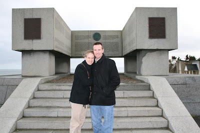 Ashley and Kenny pose in front of the National Guard Memorial at Omaha Beach.
