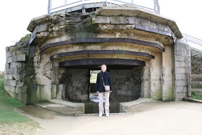 Ashley in front of on of the fortifications for the 110mm guns that the Rangers were charged with disabling at Pointe du Hoc