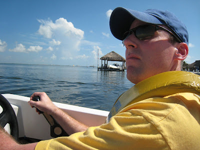 I am driving our boat on the Jungle Tour towards the reef in Cancun, Mexico