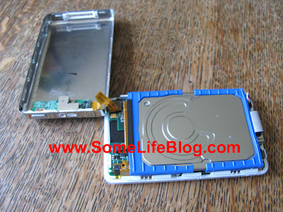 Rotate the case to expose the hard drive on Apple iPod Photo 20GB upgrade to 60GB hard drive
