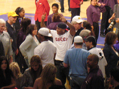 Rapper Nelly at Staples Center chest bumping with Al Harrington and Stephen Jackson after the Warriors beat the Lakers