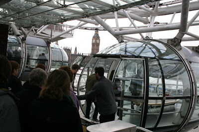 Boarding our capsulized pod for the London Eye