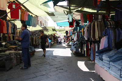 And of course there is the famous Florence open air market where you can buy leather goods, souvenirs, scarfs, ties, and more -- all while negotiating with the street vendors and their shops behind.