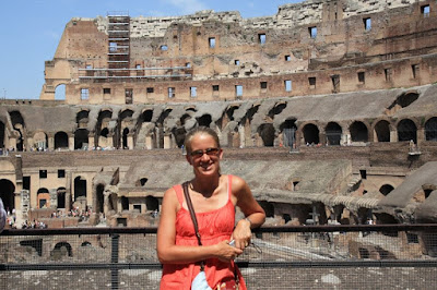 Ashley taking a quick photo from inside the Coliseum in Rome.