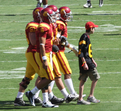 The USC Team captains including Mark Sanchez head towards the center of the field at the 50-yard line for the coin toss.