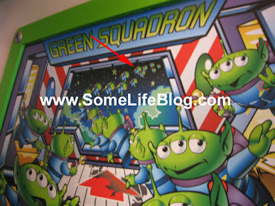 Hidden Mickey in the Green Squadron Mural on the Buzz LightYear Ride in Tomorrowland at Disneyland