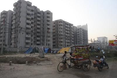The main road in Gurgaon.  Huge developments going in there with massive luxury apartments and still the roadside vendors.