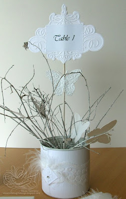 table number and centerpiece for white wedding