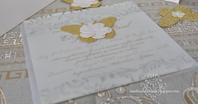 gold and cream wedding inviattion with butterfly