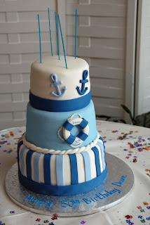 A 5oth Birthday With Nautical Theme This 3 Tiered Cake Was Carrot Cream Cheese Buttercream And Creme Bouquet Flavored Rolled Fondant