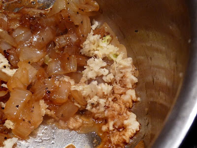 adding garlic to sauteed onions