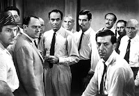 Scene of Twelve Angry Men with all jury members staring at the camera
