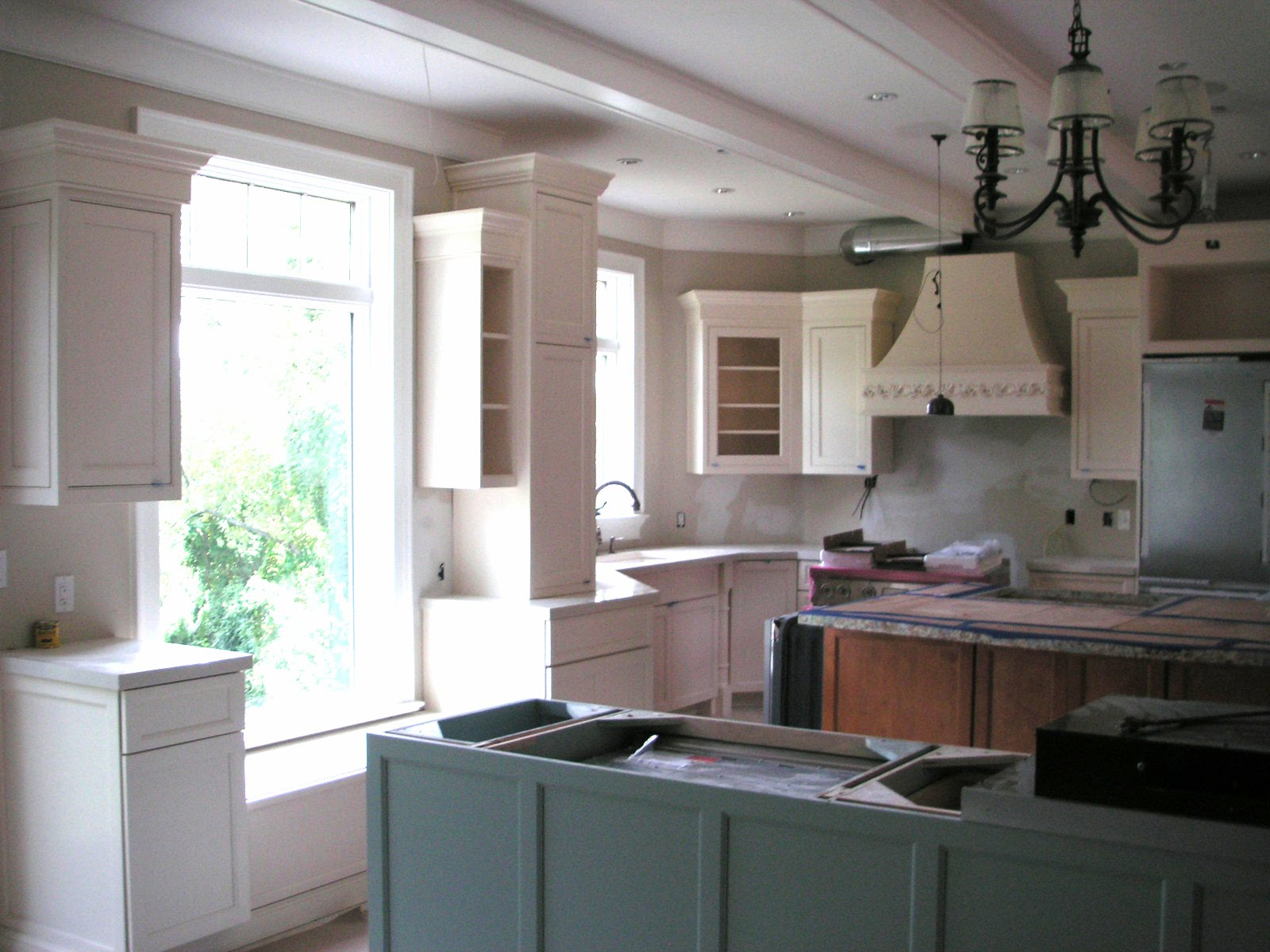 Forte Sherwin Williams Quietude Ivory Lace Painted Kitchen Cabinets