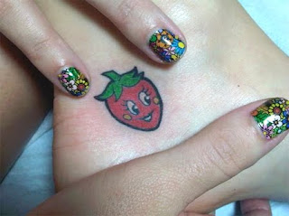 katy perry strawberry tattoo