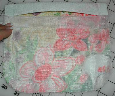Trim seam allowances close to stitching, with pinking shears. Using