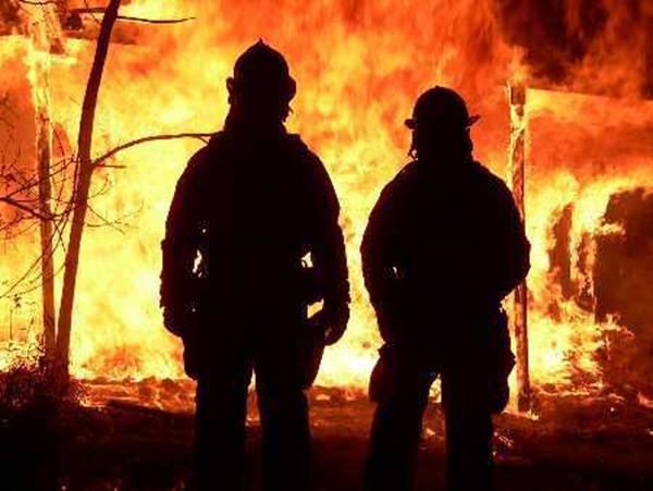 [firefighters+face+blaze]