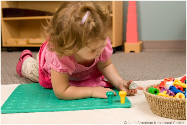 NAMC montessori entry items how to incorporate into classroom girl playing on mat