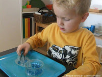 NAMC montessori preschool practical life activities follow the child working with tweezers
