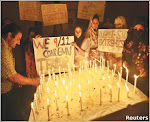 MULTAN - Sept 11: Students of a college light candles to mark the 7th anniversary of the 9/11 attac