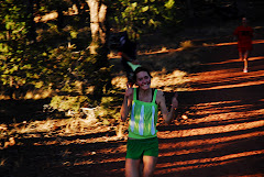 Kelsey Lewis is all smiles at the finish at the top of Red Hill
