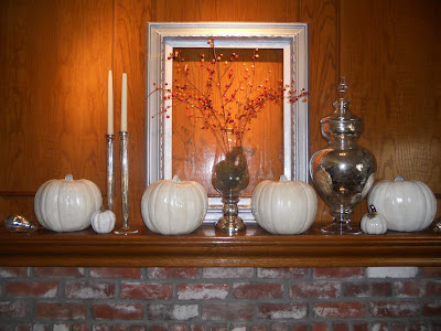 fall mantel with white pumpkins
