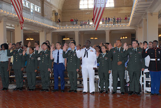 Members of the United States Armed Forces are sworn in as citizens at Ellis Island