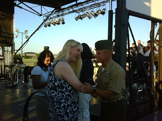 Samantha Eddleman receives congratulations from Col. Lecce after becoming a US citizen on July 4 at Camp Lejeune, North Carolina