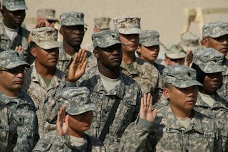 A group of soldiers takes the Oath of Allegiance