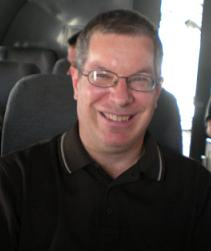 Picture of Ken on a plane flying from Kabul, Afghanistan to Bagram AFB, Afghanistan in April 2009