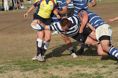 BYU Rugby Center Sean Howard breaks through the last line of Air Force defense for a decisive try
