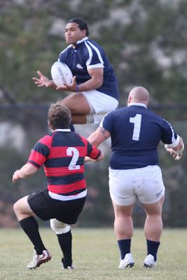 Center Paul Lasike gathers a kick