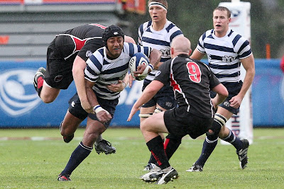 Flanker Apenisa Malani looks ahead to the SDSU scrumhalf, an SDSU prop in tow