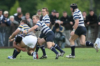 The BYU Rugby defense swarms a Cal prop, stopping his advance