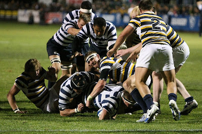 Lock Kyle Sumsion goes to ground with a stack of BYU forwards in position to ruck over