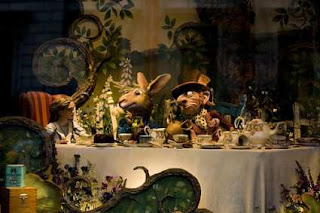 Alice. The March Hare, The Mad Hatter and the Dormouse at tea