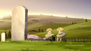 Ed and Al sit by their mother's grave