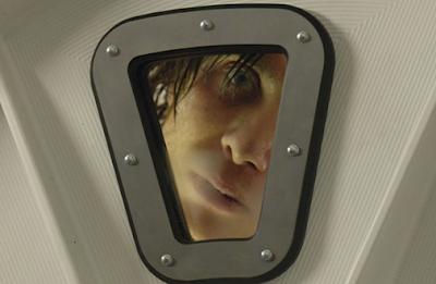Creepy Blue Eyes looks through a window