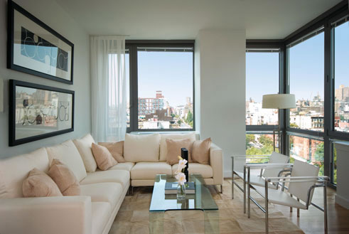 Modern-living-room-interior-with-glass-table-metal-chairs-soft-beige-sofa-big-windows