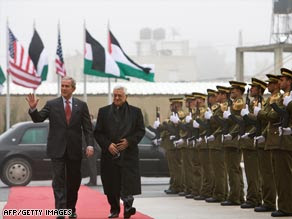 Palestinian President Mahmoud Abbas holds a welcoming ceremony for Bush on Thursday.