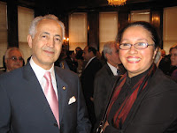 Hala Al-Saraf, right, stands with Iraqi Ambassador to the U.S. Samir Shakir Al-Sumaydi after receiving an award from the Embassy of Iraq for outstanding work in helping her people. Hala now returns to Iraq in hopes of working with Iraqi legislators to create a more sustainable health policy.