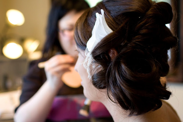Bride getting make-up done before her wedding by Atlanta wedding photographer