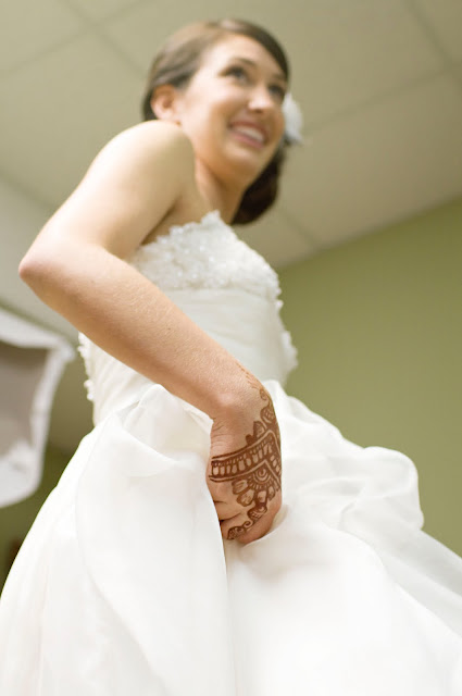 Bride getting ready shot with henna tattoo on hand - wedding photographer in Atlanta