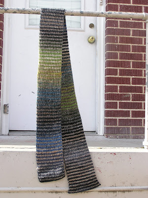 striped scarf hanging in front of a doorway