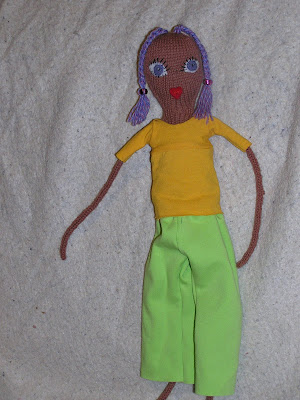 doll in yellow shirt and green pants