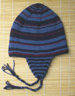 Urban ear-flap hat features random stripes
