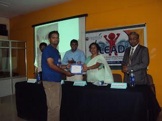 Shashank receiving best event award from geetha bali