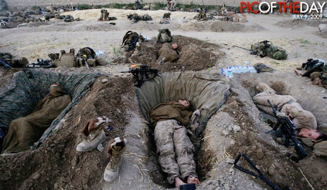 US Marines sleep inside their compound in the Nawa district