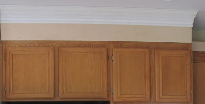 Adding height to your kitchen cabinets for Adding crown molding to existing kitchen cabinets